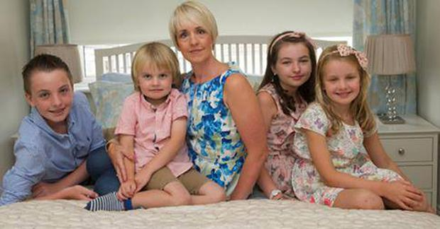 Mum-of-four Lucy Wolfe with her family.