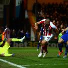 Jonathan Walters turns to celebrate scoring Stoke City's fourth goal against Rochdale