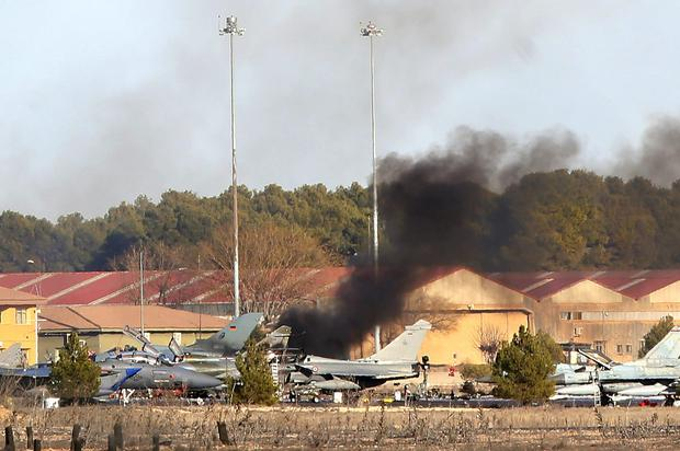 An official at Spain's defence ministry said at least 13 other people were injured when the plane hit others parked on the ground, causing an explosion and plumes of black smoke