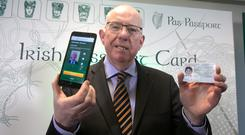 Minister for Foreign Affairs and Trade, Charlie Flanagan, TD during the announcement of details of a new Passport Card & An accompanying app, through which citizens can apply for a Passport Card,which will become available later in 2015 at the Passport Office, Molesworth Street, Dublin