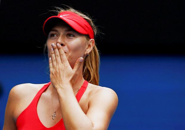 Maria Sharapova of Russia celebrates after defeating Eugenie Bouchard of Canada in their women's singles quarter-final match at the Australian Open 2015