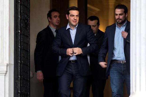 Newly appointed Greek Prime Minister and winner of the Greek parliamentary elections, Alexis Tsipras (2nd L), walks with members of his cabinet in Athens. Reuters