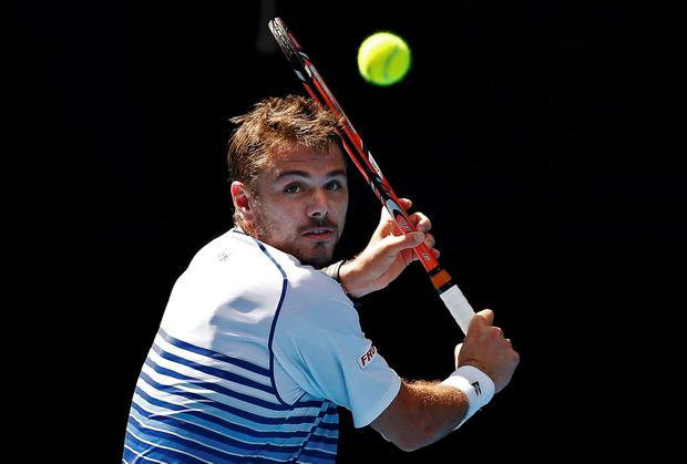 Stan Wawrinka of Switzerland prepares to hit a return to Kei Nishikori of Japan during their men's singles quarter-final match at the Australian Open