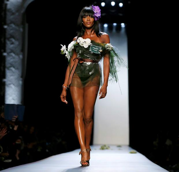 Model Naomi Campbell presents a creation by French designer Jean Paul Gaultier as part of his Haute Couture Spring-Summer 2015 fashion show in Paris