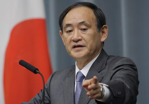 Japan's Government spokesman Chief Cabinet Secretary Yoshihide Suga points a reporter during a press conference at the prime minister's official residence in Tokyo Thursday, Jan. 29, 2015. Japan was studying the latest message purportedly from the Islamic State group, which extends the deadline for Jordan's release of an Iraqi prisoner, while officials worked feverishly Thursday to try to free Japanese journalist Kenji Goto held by the militants. Suga said the government was in close communications and