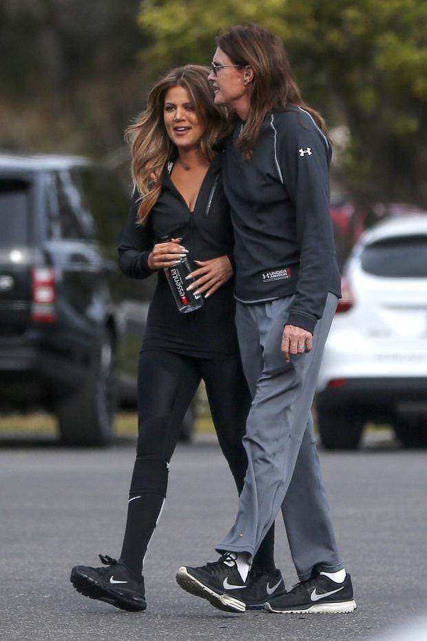 Khloe Kardashian can't keep her smile off her face as she grabs Bruce Jenner for some quality father-daughter time during a day trip to Pismo Beach. Picture by: AKM-GSI / Splash News