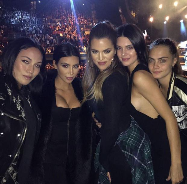 Kim and Khloe Kardashian with Kendall Jenner and Cara Delevingne