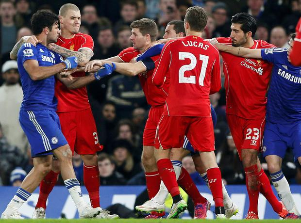 Chelsea's Diego Costa (L) argues with Liverpool's Steven Gerrard (3rd L) during their English League Cup semi-final second leg soccer match at Stamford Bridge
