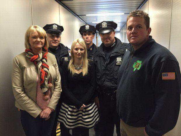 At Newark Liberty International Airport today, Port Authority Police officers welcomed the mother and wife of Garda Brian Hanrahan. His mother, Rosemary Hanrahan, and wife, Emma Holland, are seen here with (l-r) Officers Slavek Wdoviak, Greg Ross, Mike Becker and Bob Wallace. Pic: Port Authority Police Benevolent Association