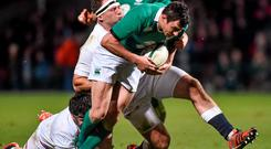 Felix Jones, Ireland Wolfhounds, is tackled by Henry Thomas, and Rob Webber, below, England Saxons