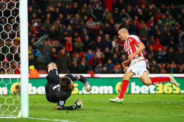 STOKE ON TRENT, ENGLAND - JANUARY 31: Jonathan Walters of Stoke City turns to celebrate after scoring in their third goal for a hatrick during the Barclays Premier League match between Stoke City and Queens Park Rangers at Britannia Stadium on January 31, 2015 in Stoke on Trent, England. (Photo by Richard Heathcote/Getty Images)