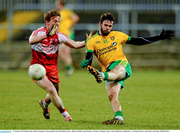 31 January 2015: Odhr?n Mac Niallais, Donegal, in action against Liam McGoldrick, Derry. Allianz Football League Division 1, Round 1, Donegal v Derry. MacCumhail Park, Ballybofey, Co. Donegal Picture credit: Oliver McVeigh / SPORTSFILE