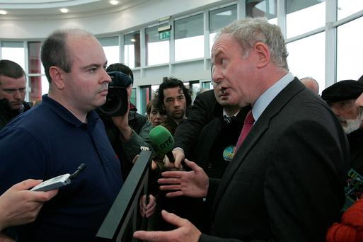 David Kelly confronts Presidential candidate Martin McGuinness. Photo Ann Hennessy.
