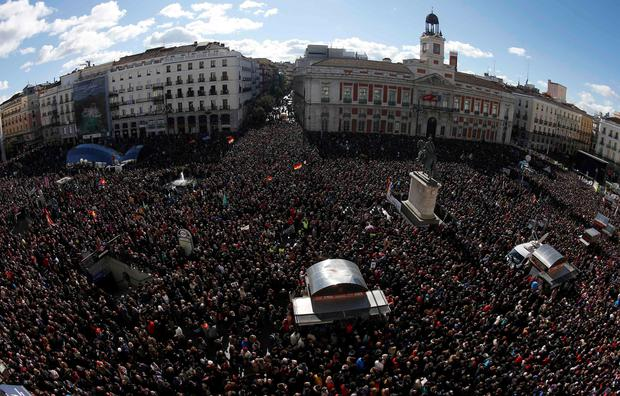 People fill Madrid's landmark Puerta del Sol as they gather at a rally called by Spain's anti-austerity party Podemos (We Can). Tens of thousands marched in Madrid on Saturday in the biggest show of support yet for Podemos, whose surging popularity and policies have drawn comparisons with Greece's new Syriza rulers (REUTERS/Sergio Perez)