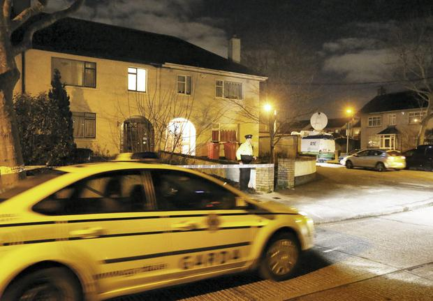 A Garda on duty at The Glendhu Road, Cabra house where a body was discovered last night.