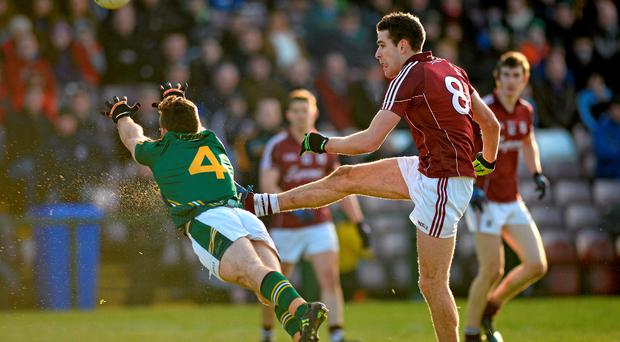Meath's Mickey Burke tries to get a block on Fiontan O Curraoin of Galway during their clash in Pearse Stadium
