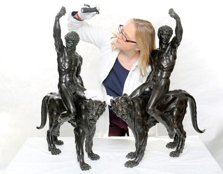 Dr Victoria Avery, Keeper of Applied Arts at the Fitzwilliam museum in Cambridge examines two Bronze sculptures thought to be works by Michelangelo (Chris Radburn/PA Wire)