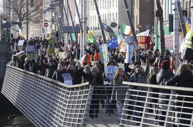Protesters show their support against charges during a water charges demonstration in Dublin this afternoon