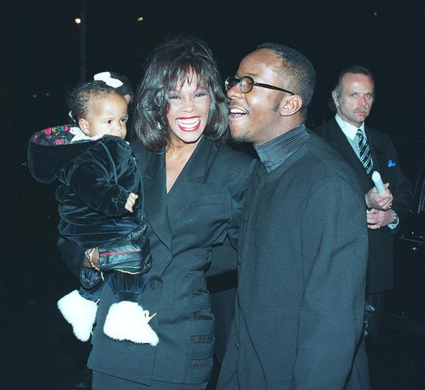 Whitney Houston and Bobby Brown with daughter, Bobbi Kristin at Bobby's 25th birthday at Tavern On The Green in NYC in 1994