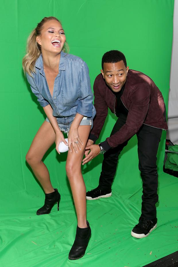 Model Chrissy Teigen (L) and musician John Legend attend the DIRECTV Super Fan Tailgate at Pendergast Family Farm on February 1, 2015 in Glendale, Arizona. (Photo by Taylor Hill/Getty Images for DirecTV)