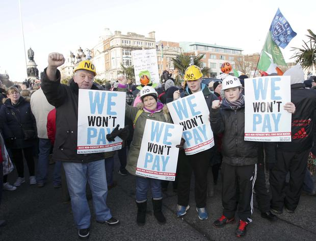 People show their support against charges during a water charges demonstration in Dublin at the weekend
