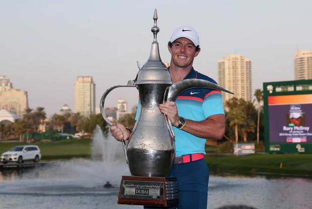 Rory McIlroy of Northern Ireland holds the trophy after he wins the final round of the Dubai Desert Classic golf tournament in United Arab Emirates, Sunday, Feb. 1, 2015