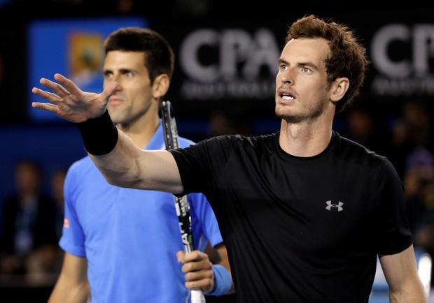 Novak Djokovic of Serbia, left, and Andy Murray of Britain walk to the chair umpire after Djokovic won the men's singles final at the Australian Open tennis championship in Melbourne, Australia, Sunday, Feb. 1, 2015