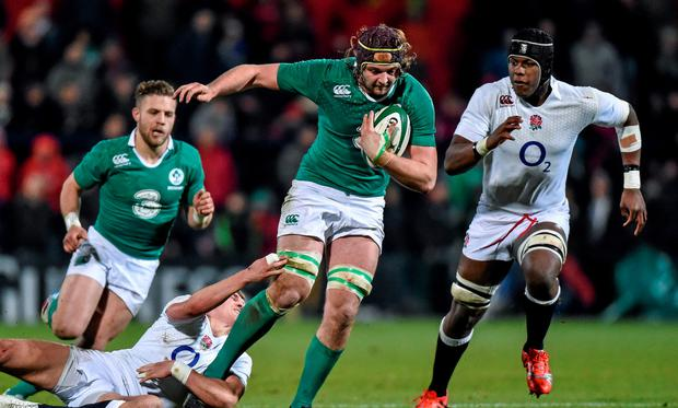 Iain Henderson, Ireland Wolfhounds, is tackled by Henry Slade, England Saxons
