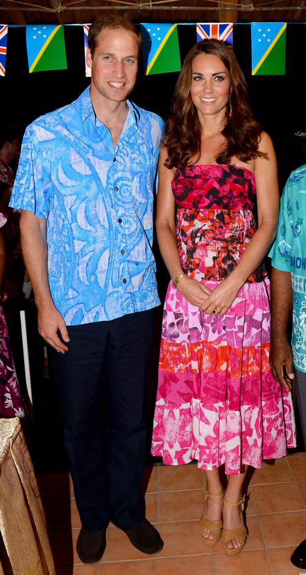 Britain's Prince William (L) and his wife Catherine (R), the Duchess of Cambridge, pose for a photo in Honiara in 2012
