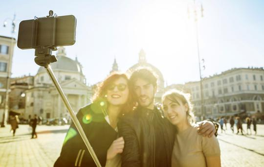Friends taking a selfie in Rome