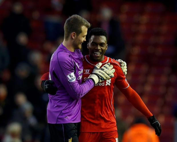 Liverpool's Daniel Sturridge (R) and goalkeeper Simon Mignole embrace after their English Premier League soccer match against West Ham United at Anfield