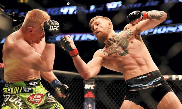 18 January 2015; Conor McGregor, right, in action against Dennis Siver. UFC Fight Night, Conor McGregor v Dennis Siver, TD Garden, Boston, Massachusetts, USA