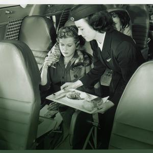 An Aer Lingus cabin crewmember on board the Super Constellation aircraft that flew transatlantic routes.