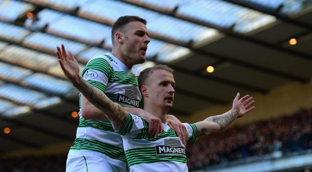 Anthony Stokes celebrates with Leigh Griffiths who scored Celtic's opening goal in their Scottish League Cup semi-final against Rangers at Hampden Park. Photo: Jamie McDonald/Getty Images