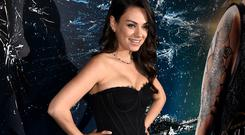 Actress Mila Kunis attends the premiere of Warner Bros. Pictures'