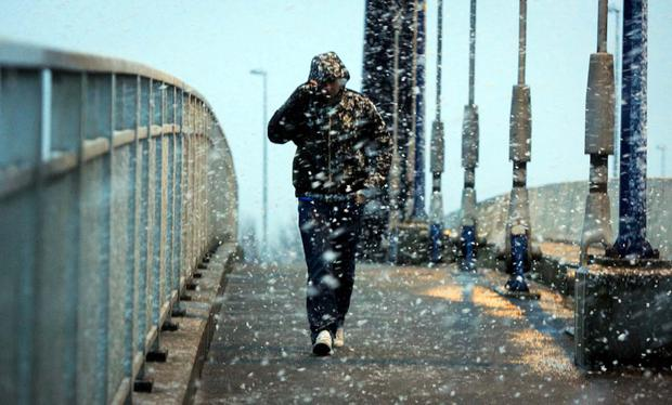 Members of the public brave the snow weather in Clondalkin, Dublin