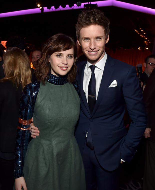 Actors Felicity Jones (L) and Eddie Redmayne attend the 87th Annual Academy Awards Nominee Luncheon at The Beverly Hilton Hotel
