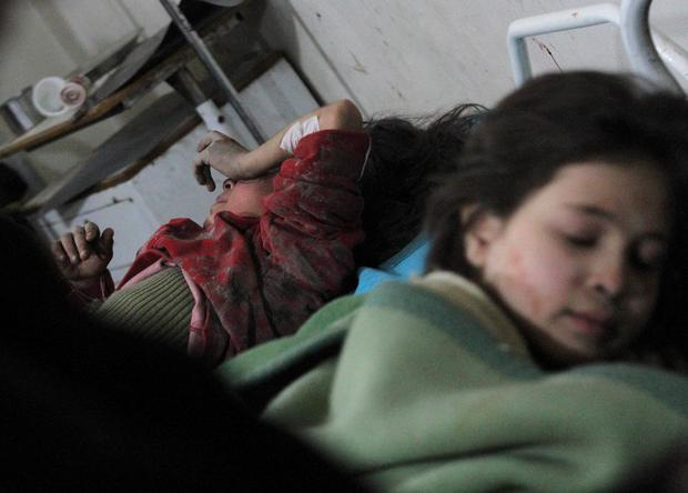 Injured girls lie in a field hospital, after what activists said was an airstrike by forces loyal to Syria's President Bashar al-Assad, in the Duma neighborhood of Damascus, February 3, 2015. Reuters/ Mohammed Badra