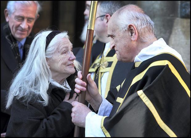 Colm Rapple's wife Nuala speaks with Fr. Nevin following the Latin High Mass at the funeral of the former Economist, Journalist at St. Kevins Church on Harrington Street. Pic Steve Humphreys