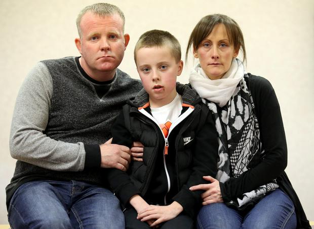 Kieran Duffy with his parents Robert and Amanda at London Road Police Station in Glasgow appeal for information after Kieran suffered a head injury whilst en-route to the Celtic v Rangers match last Sunday. PRESS ASSOCIATION Photo. Picture date: Tuesday February 3, 2015. See PA story POLICE Boy. Photo credit should read: Andrew Milligan/PA Wire