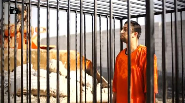 A man purported to be Islamic State captive Jordanian pilot Muath al-Kasaesbeh is seen standing in a cage in this still image from an undated video