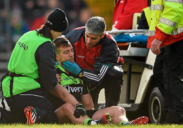 Mayo's Evan Regan is tended to after a heavy fall against Kerry. Regan was taken off with a 'blood injury' due to a cut lip