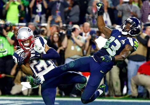 Unheralded New England Patriots cornerback Malcolm Butler (21) intercepts a pass to effectively clinch the Super Bowl