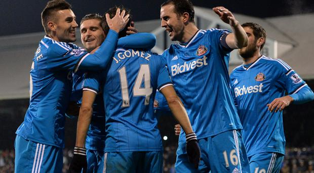 Sunderland's Spanish midfielder Jordi Gomez celebrates with teammates after scoring their third goal from the penalty spot