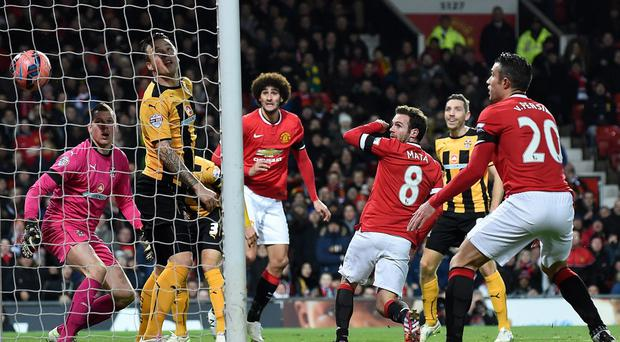 Manchester United midfielder Juan Mata scores the opening goal of the FA Cup fourth round replay against Cambridge United at Old Trafford. Photo: PAUL ELLIS/AFP/Getty Images