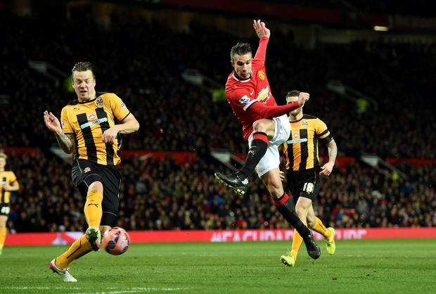 Manchester United's Robin van Persie has a shot on goal during the FA Cup, Fourth Round replay at Old Trafford, Manchester