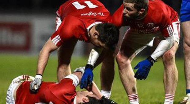 Sean Cavanagh lies on the pitch after taking a blow to the head during the National League defeat to Monaghan at Healy Park.