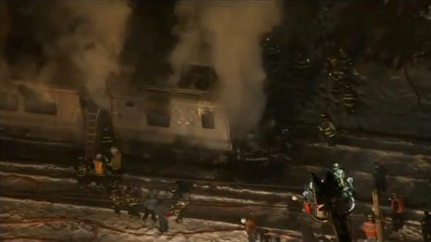 A still image captured from WNBC-TV aerial video shows first responders battling fire on a New York City -Metro-North train following an accident near Valhalla, New York February 3, 2015. REUTERS/WNBC-TV