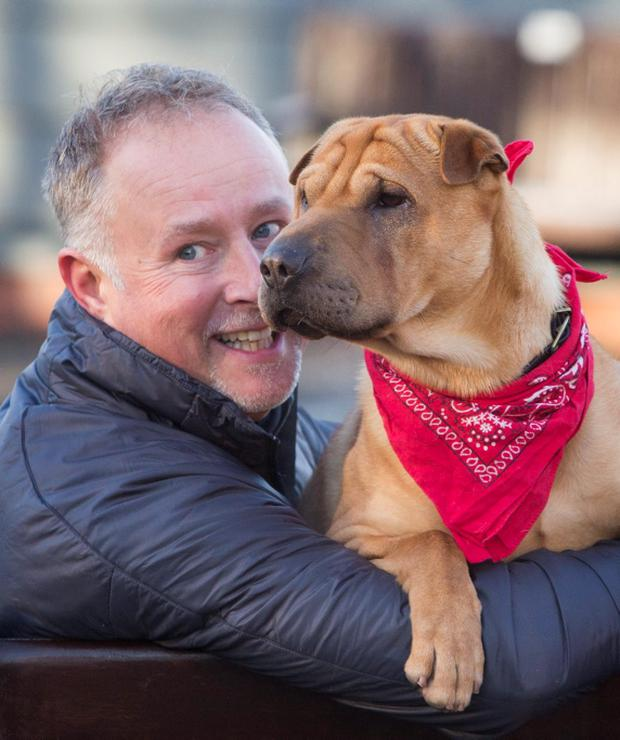 Kai the dog with his new owner Ian Russell at a Scottish SPCA office in Glasgow, after he was abandoned at a railway station with a suitcase full of his belongings. Danny Lawson/PA Wire