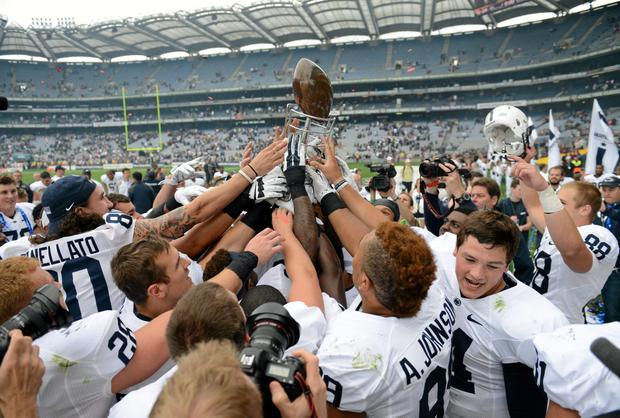 Penn State players hoist the Dan Rooney Trophy after defeating UCF in Croke Park Classic last year. Photo: Cody Glenn / SPORTSFILE